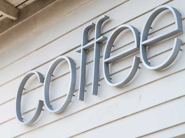 Metal storefront sign that says coffee