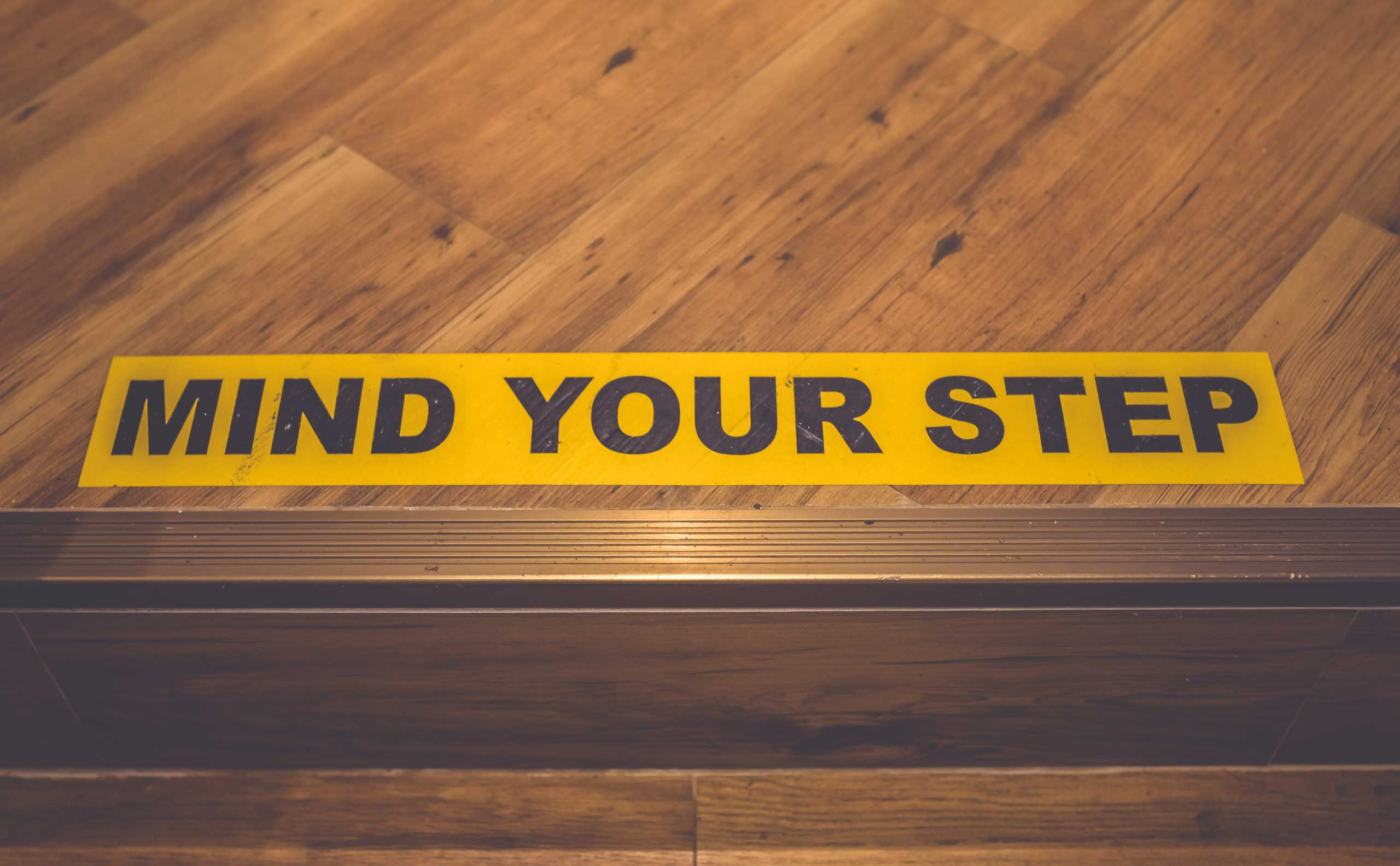 Floor decal that states mind your step