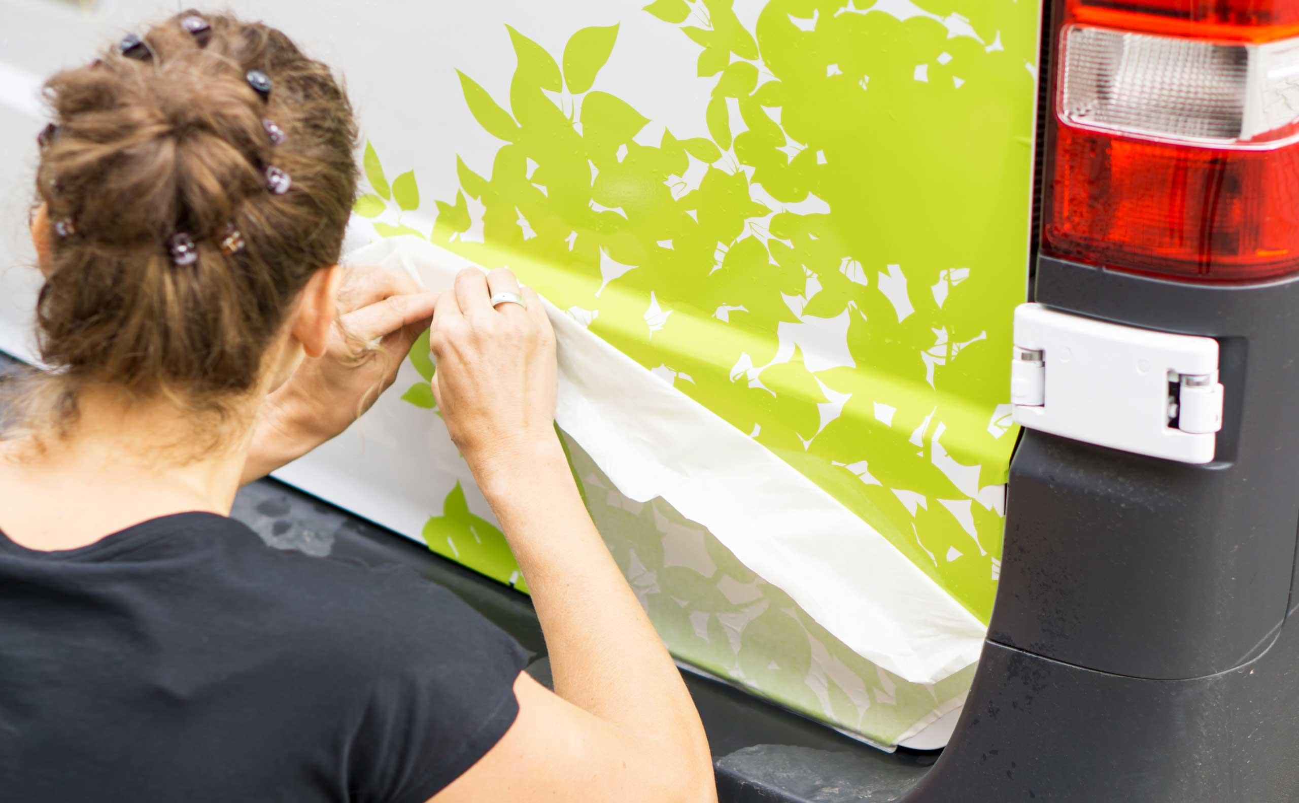 Vehicle lettering of lime green flower leaves