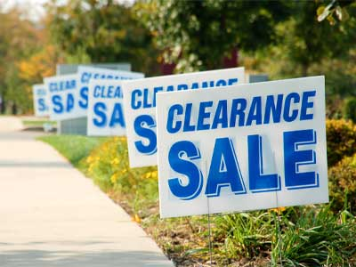 Yard signs that say clearance sale