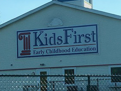 Kids First storefront sign